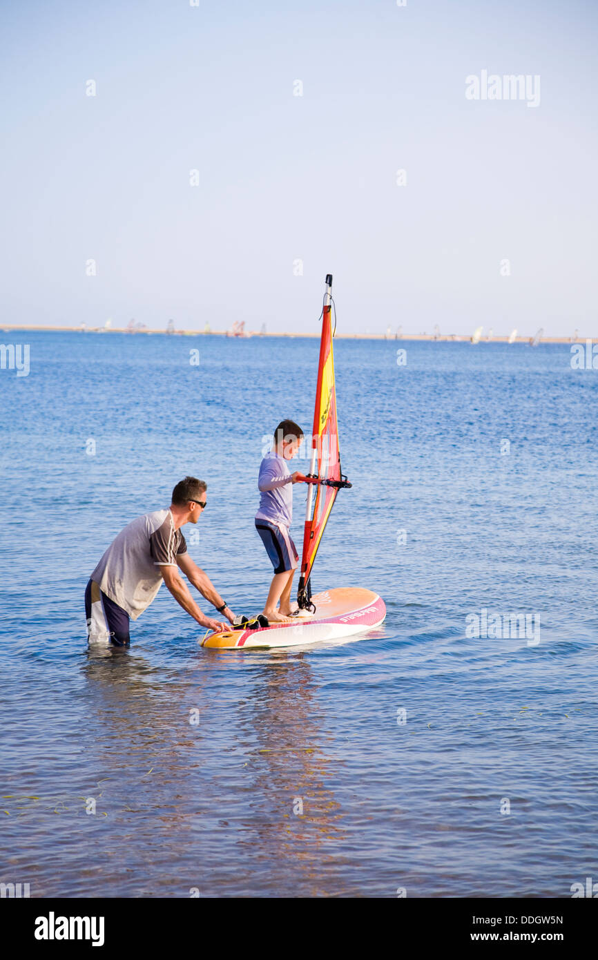 Sailboarding is a popular pursuit at Hilton Dahab Resort on the Gulf of Aqaba, Sinai Peninsula, Egypt. - Stock Image