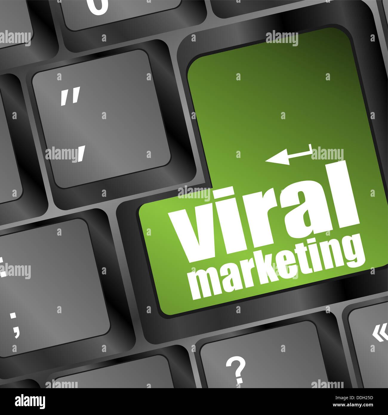 viral marketing word on computer keyboard - Stock Image