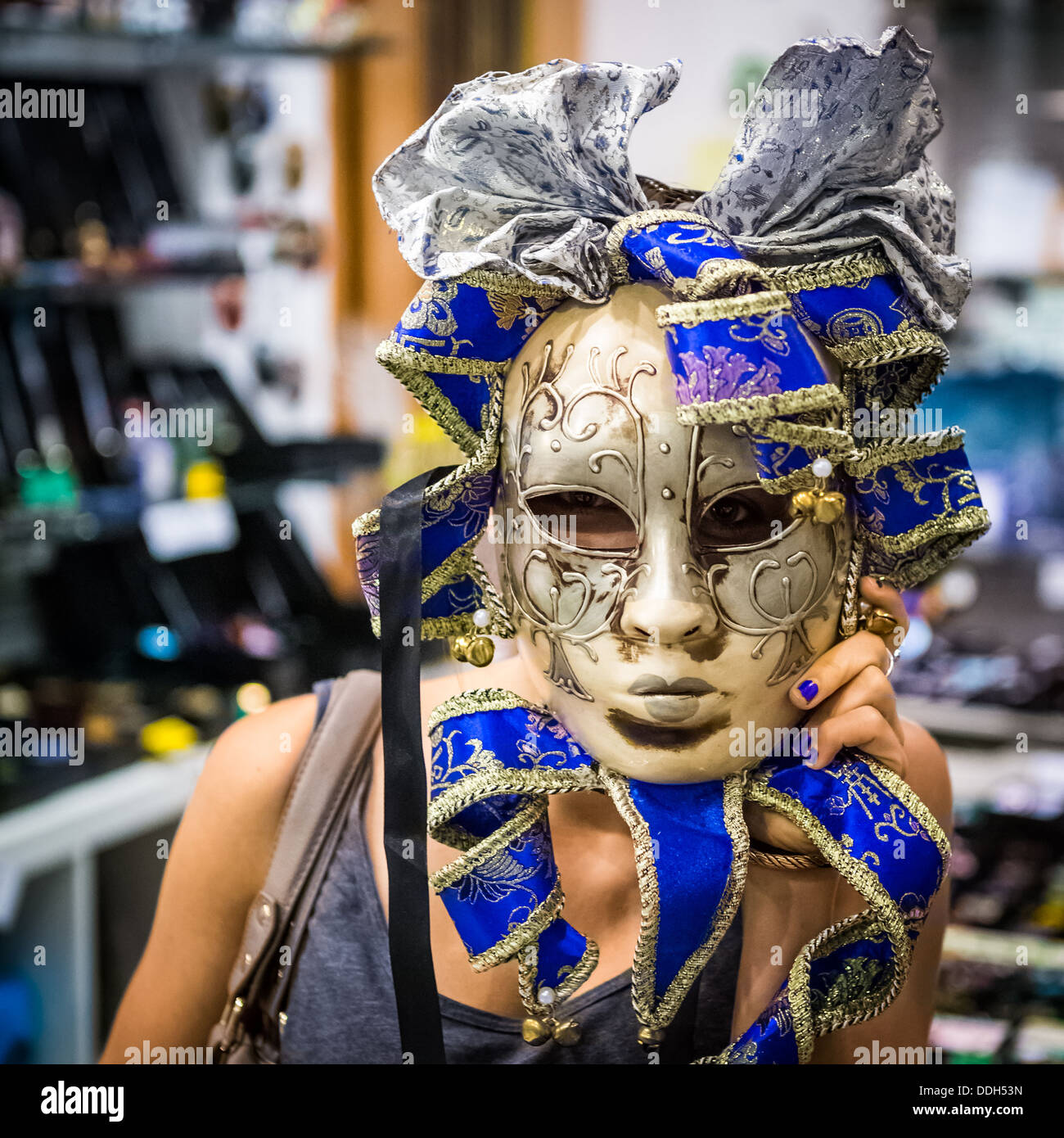 Young woman wearing a venetian carnival mask - Stock Image