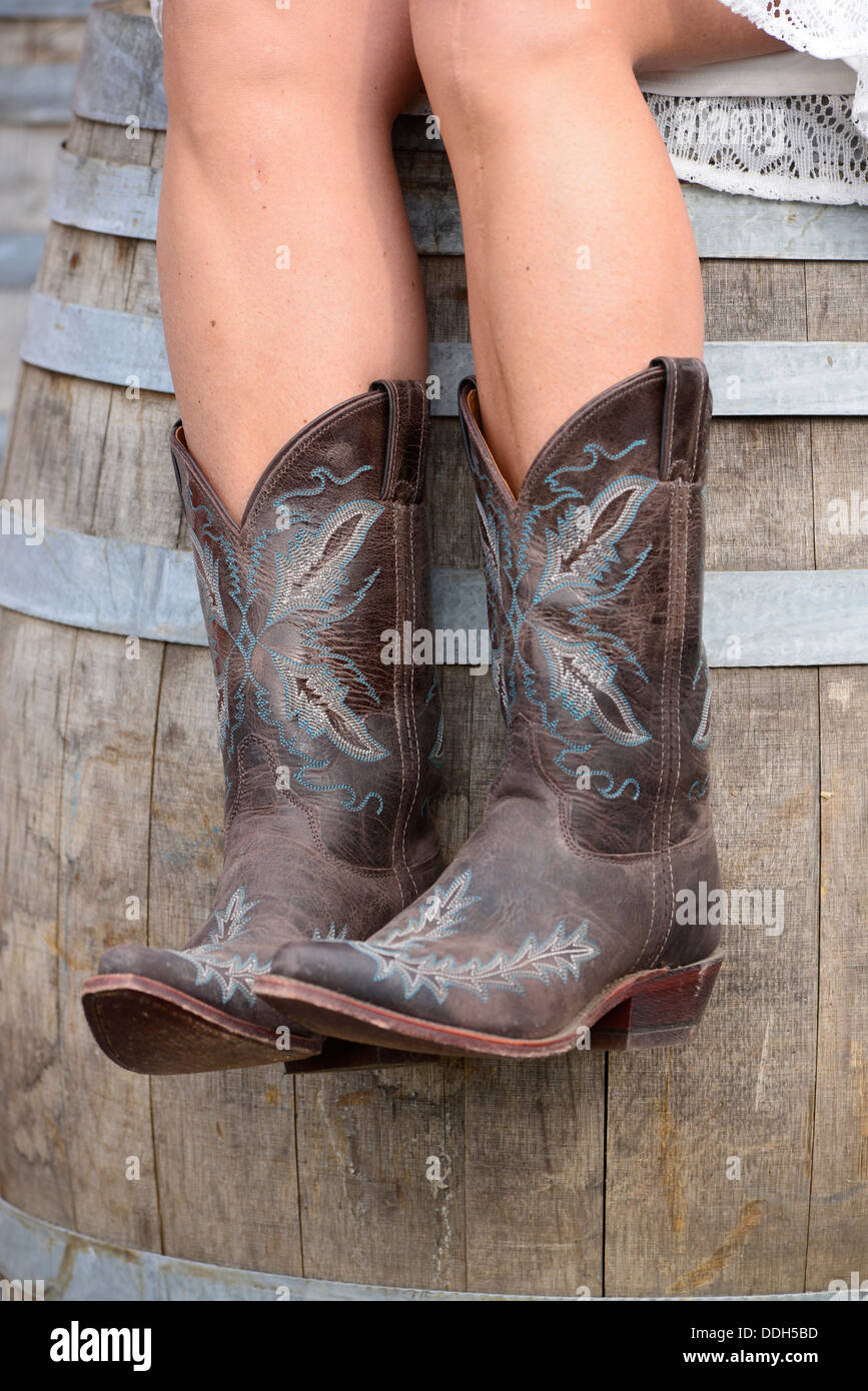 b00c8f6c5bc Woman Wearing Cowboy Boots On Stock Photos & Woman Wearing Cowboy ...