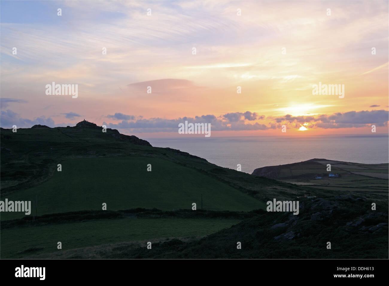 Sunset over Garn Fawr Iron Age Hillfort, Pen Caer peninsula, Pembrokeshire, Wales, Great Britain, United Kingdom, - Stock Image