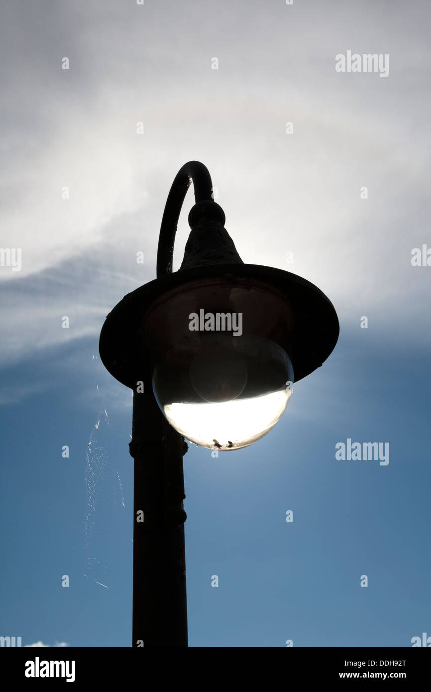 old streetlamp against sky - Stock Image
