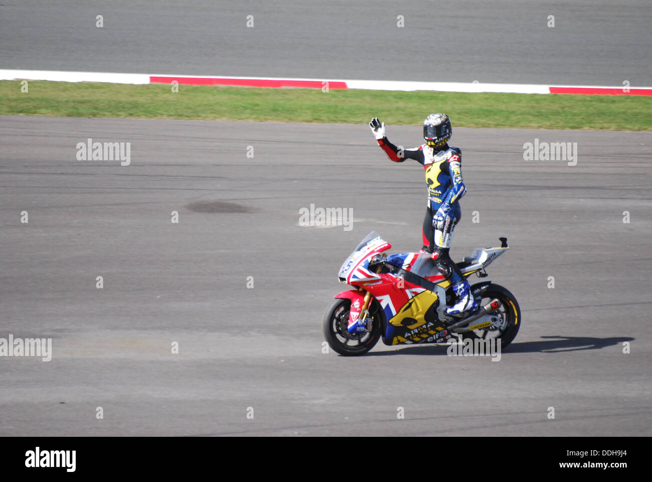Scott Redding following his victory at Silverstone in the 2013 Moto2 Race - Stock Image