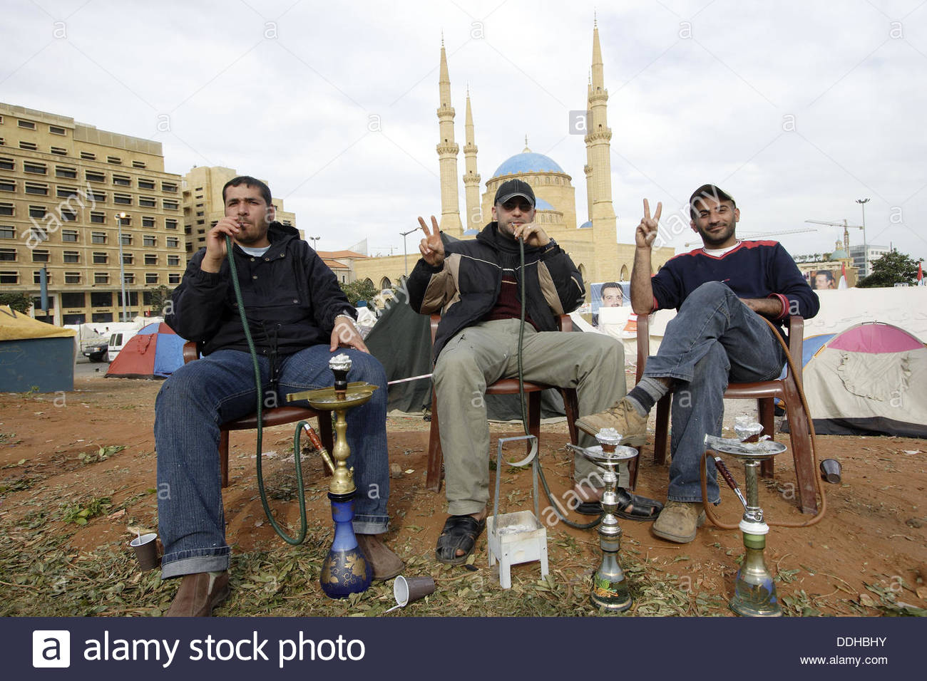 A pause for relaxation with nargileh in the central district with background the Mohammed al Amin mosque. Lebanon Beirut - Stock Image