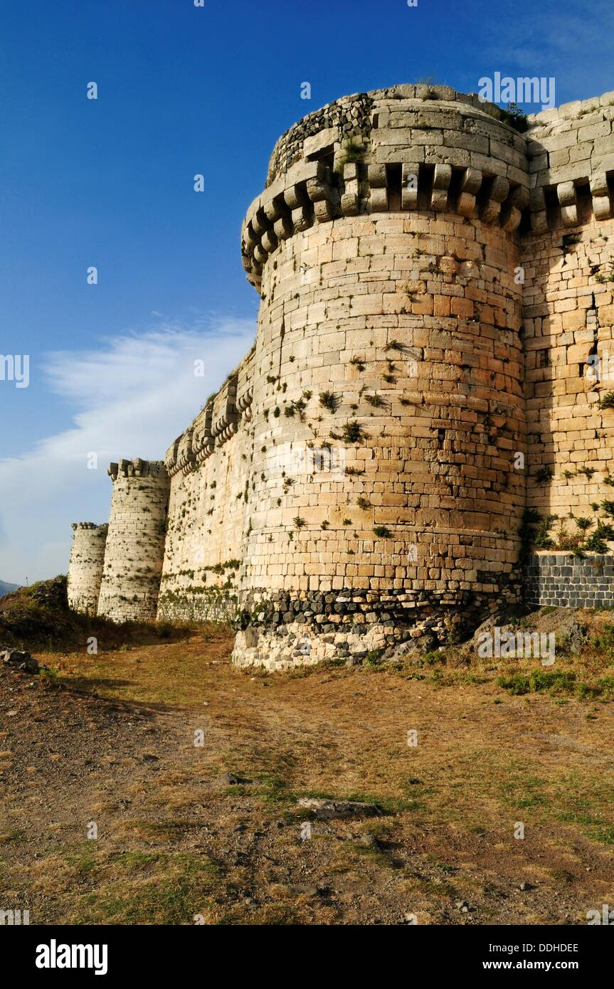 outer wall of the Crusader fortress Crac, Krak des Chavaliers, Qalaat al Husn, Hisn, Syria, Middle East, West Asia - Stock Image