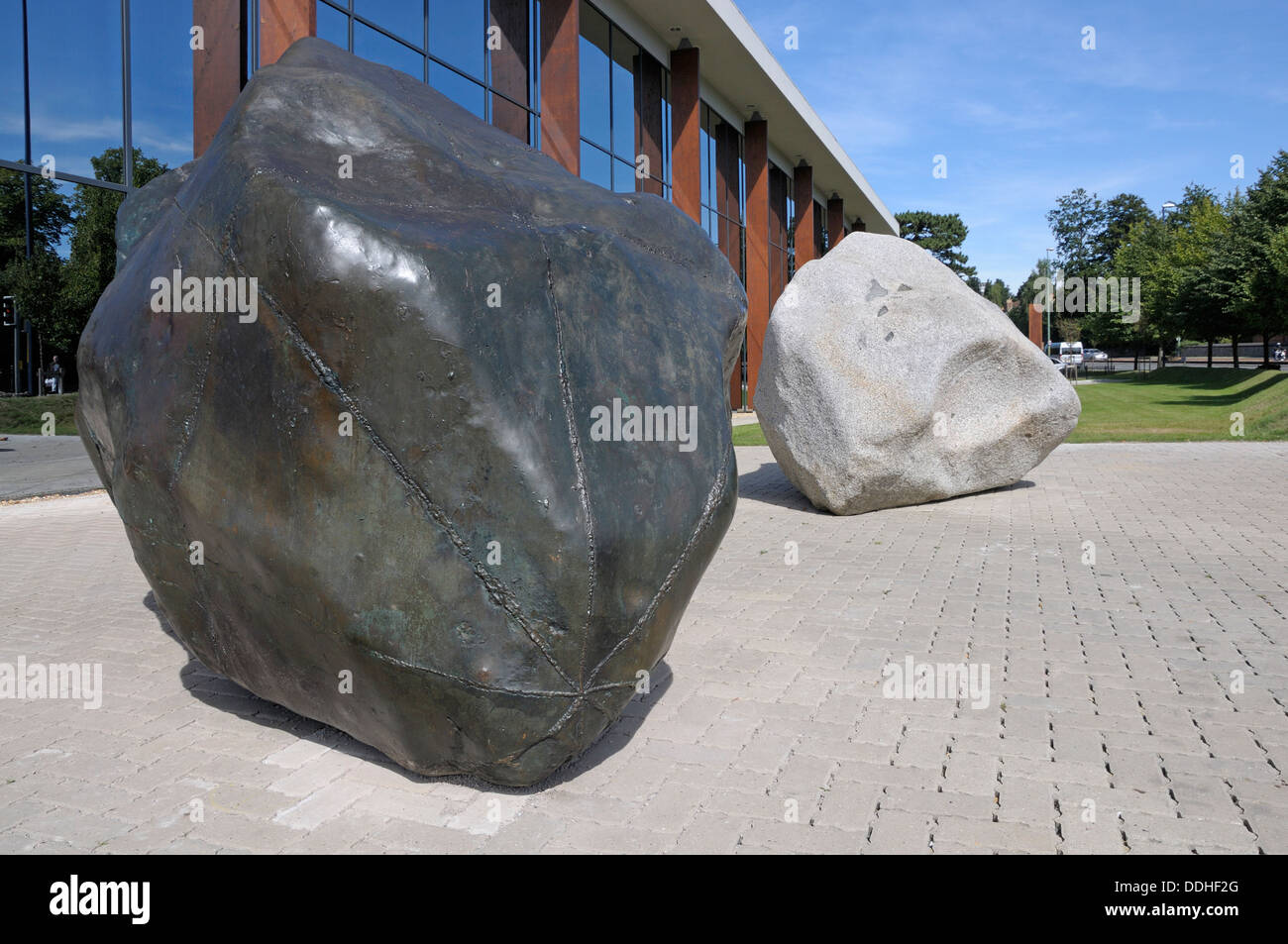 Maidstone, Kent, England, UK. The Two Stones (Antony Gormley; 1979) outside Maidstone Library. Gormley's first commissioned work - Stock Image