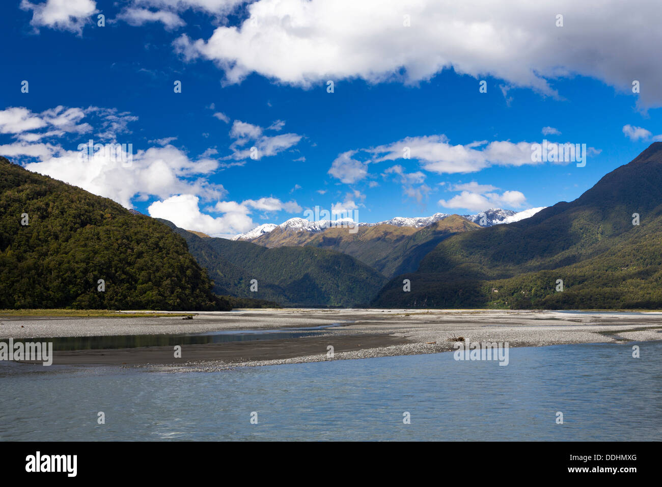 Haast River in front of the Macfarlane Ridge and Mount Macfarlane, 2057m, Southern Alps - Stock Image