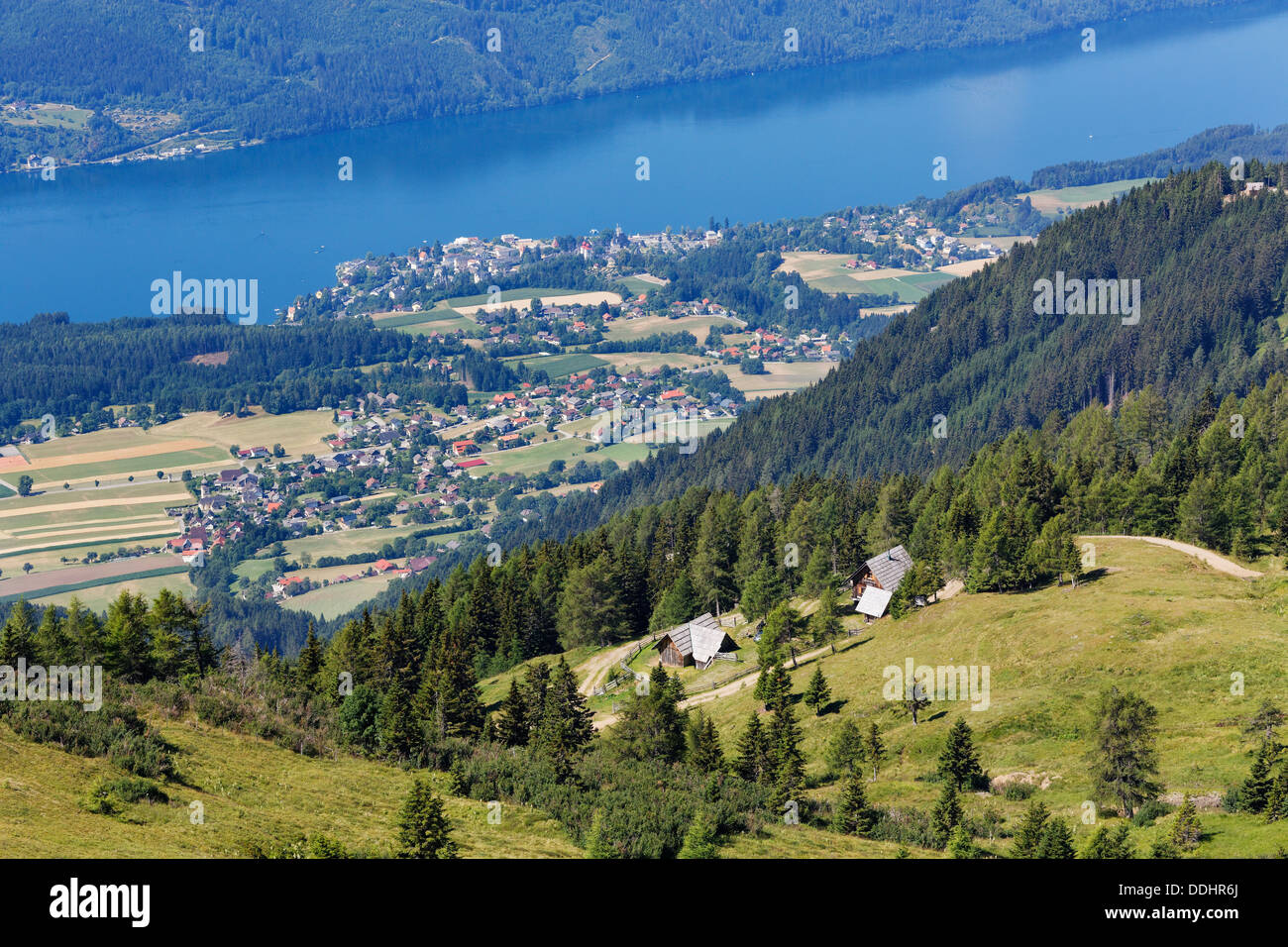 View from the Millstatt Alps over Millstatt am See and Lake Millstatt - Stock Image