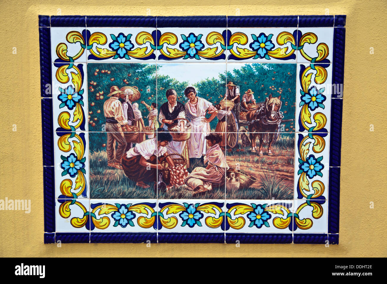 Spanish Wall Tile Mural, Harvesting the Oranges - Stock Image