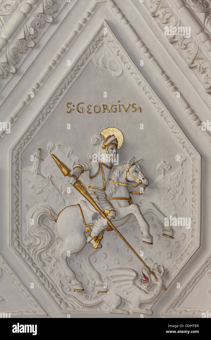 St. George slaying a dragon, stucco relief, early baroque, Church of St Andreas - Stock Image