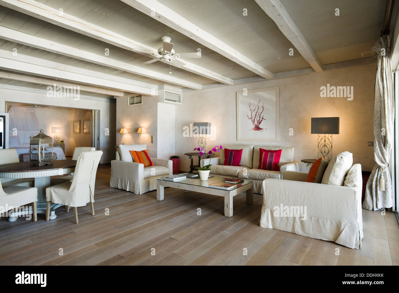 Neutral Coloured Three Piece Suite In Airy Living Room With ...