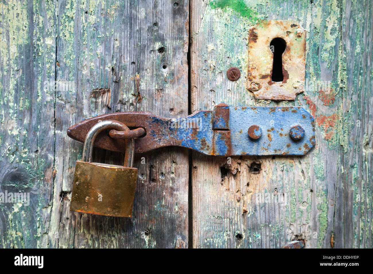 Old lock and rusted keyhole on green wooden door & Old lock and rusted keyhole on green wooden door Stock Photo ...