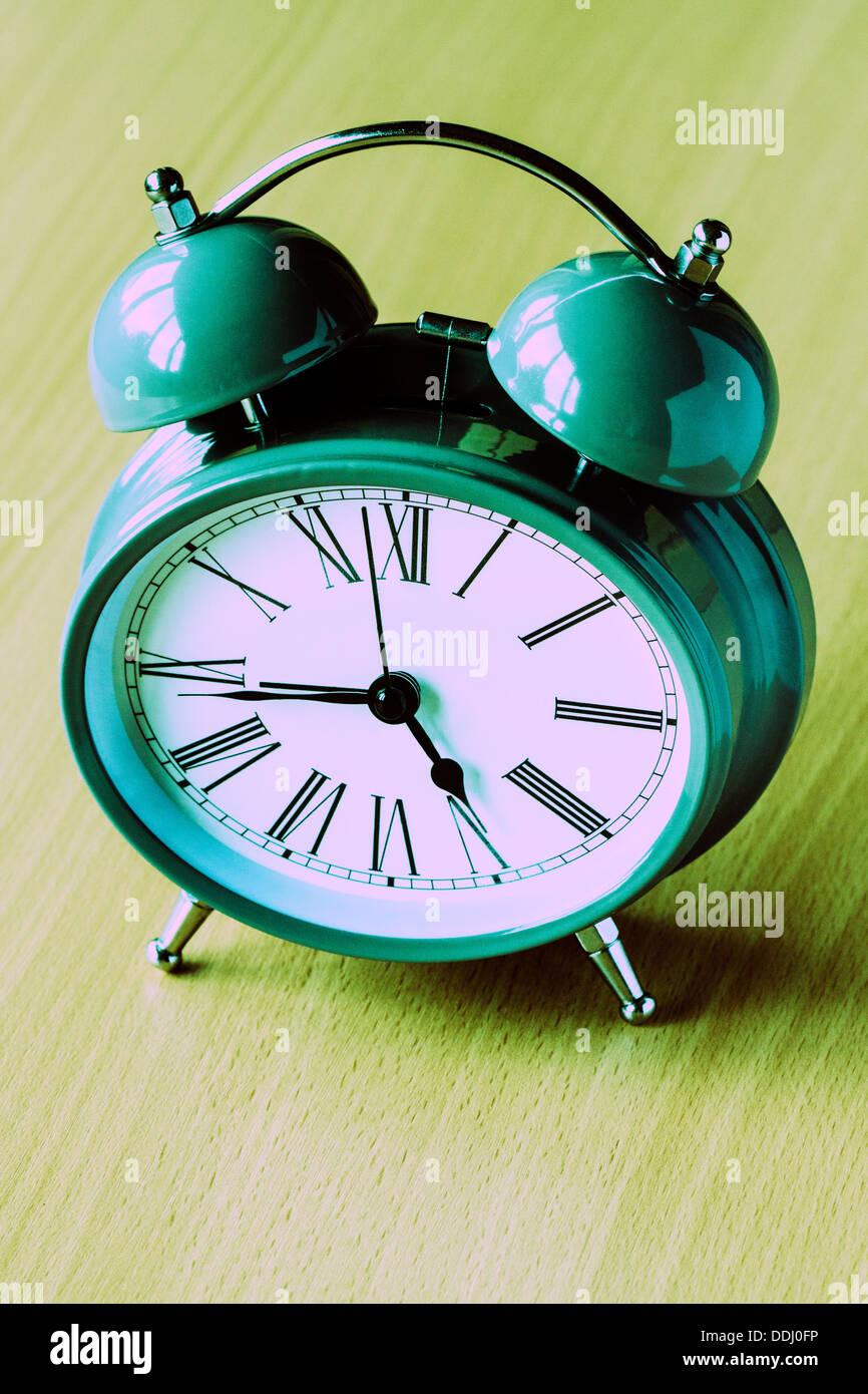 Traditional Alarm Clock, cross-processed - Stock Image