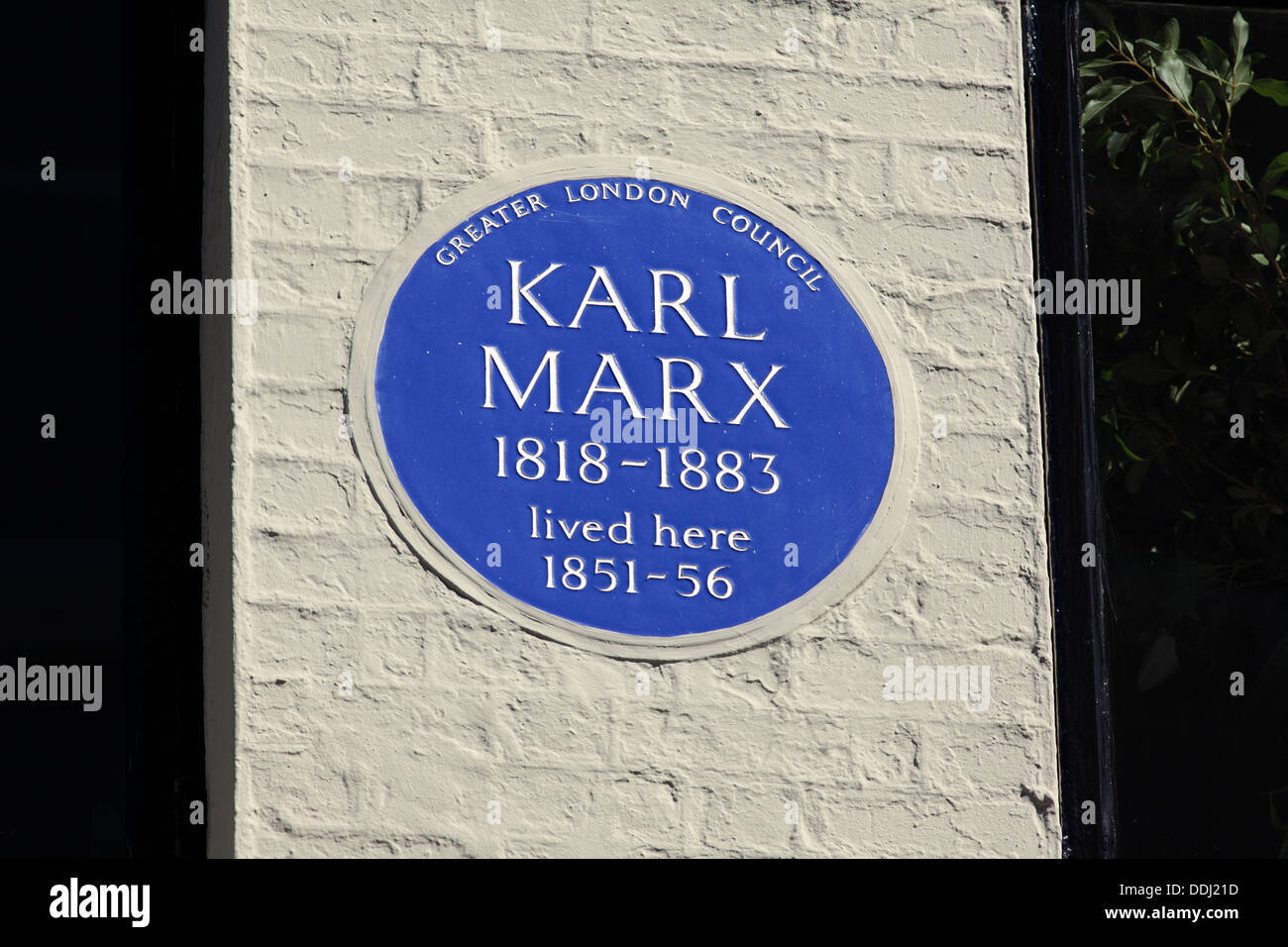 Blue plaque commemorating Karl Marx in Dean Street, London, He lived at this address in Soho in the 1850s. - Stock Image