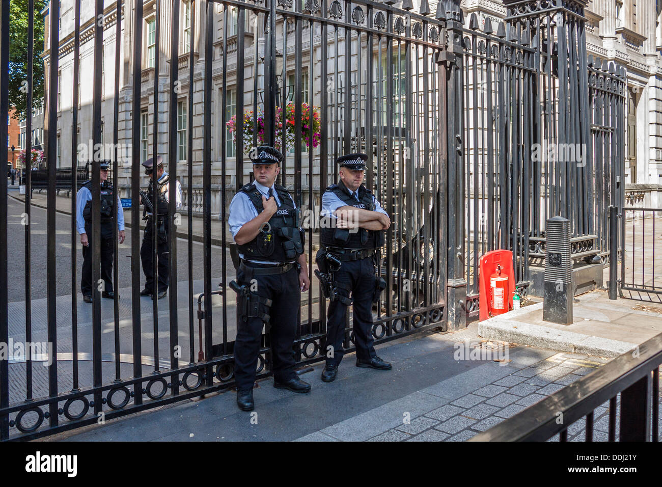 Downing Street Gates and armed police presence - Stock Image