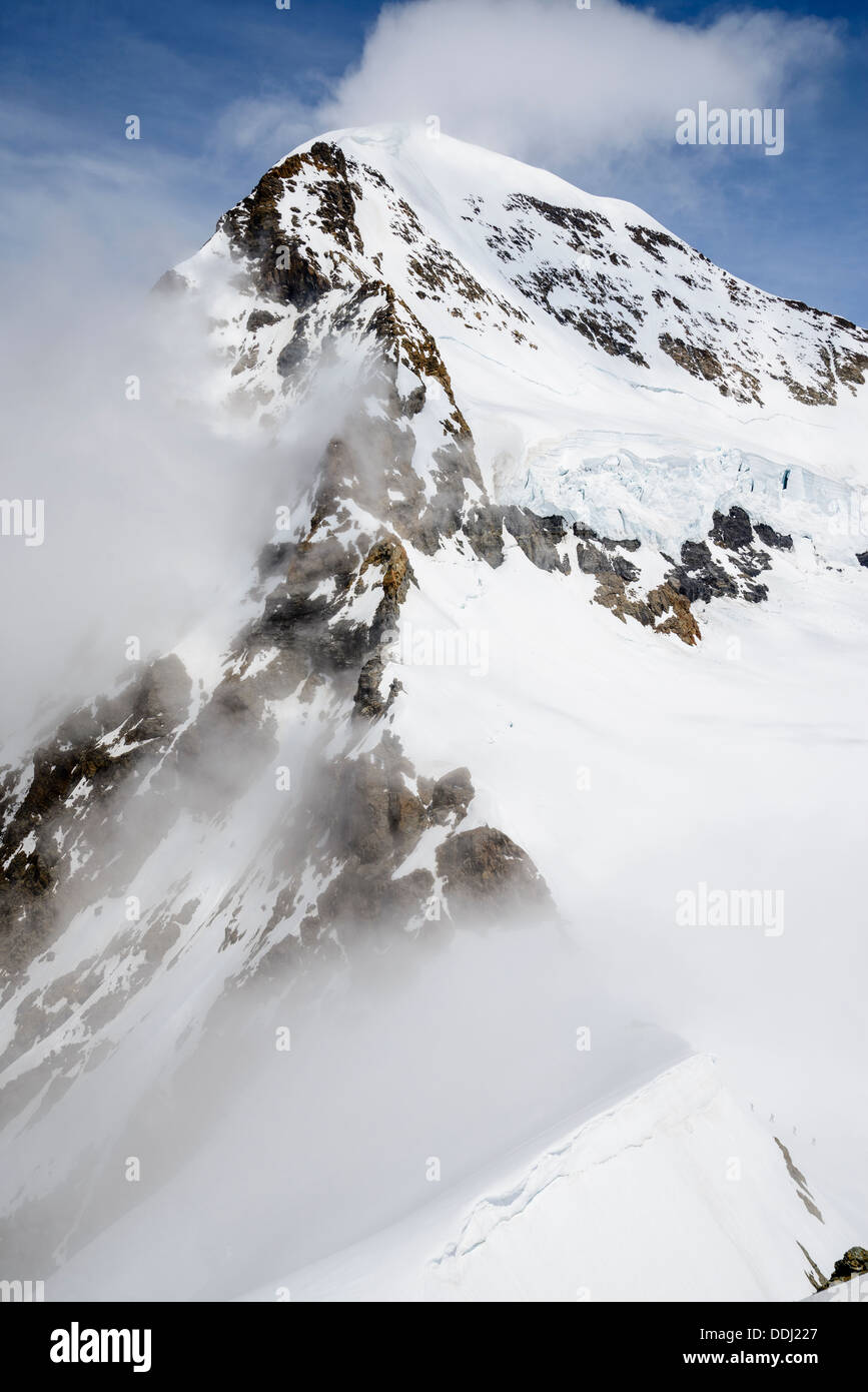 Looking up the south-west ridge of the Monch a 4107m peak near Grindelwald Switzerland - Stock Image