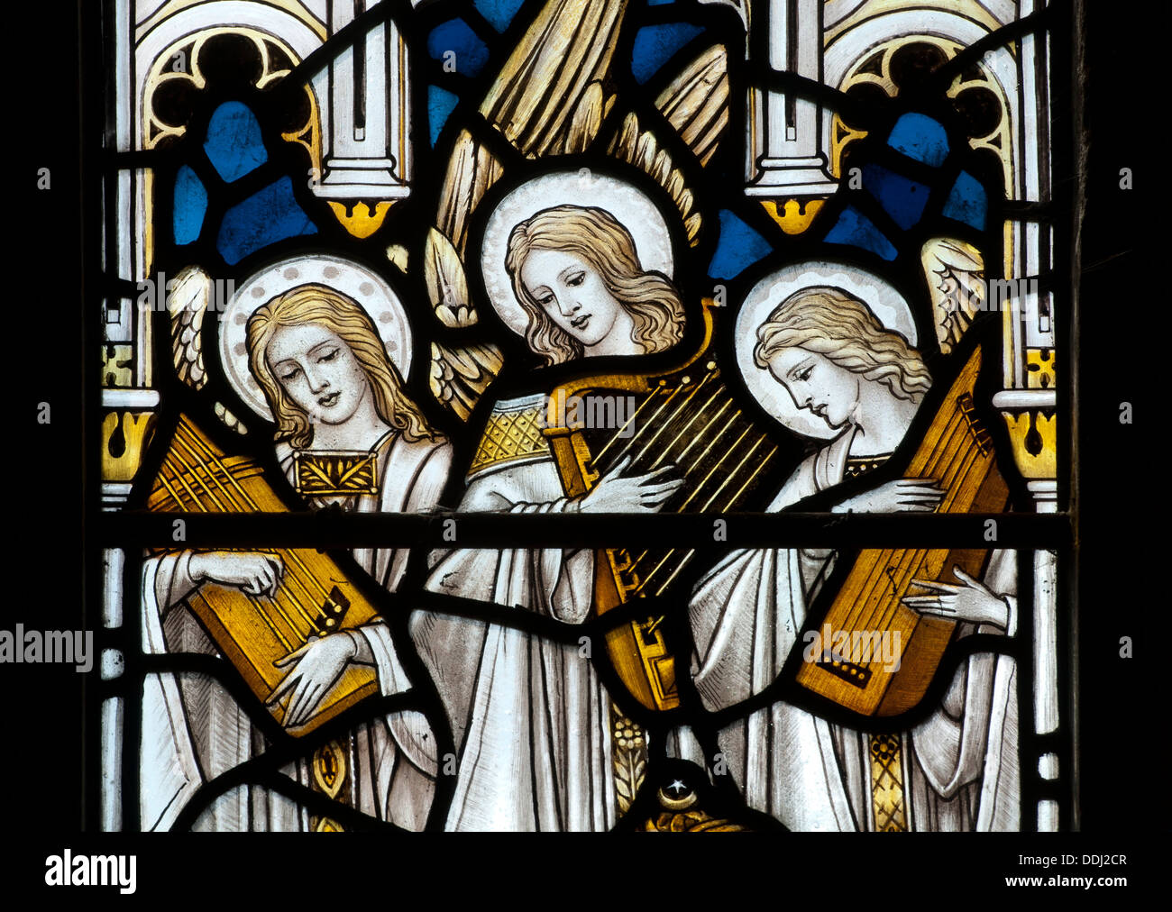 Angel musicians stained glass, St. Laurence`s Church, Wyck Rissington, Gloucestershire, England, UK - Stock Image