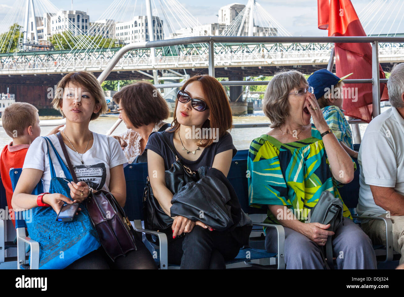 Sightseers on Thames Riverboat - Stock Image