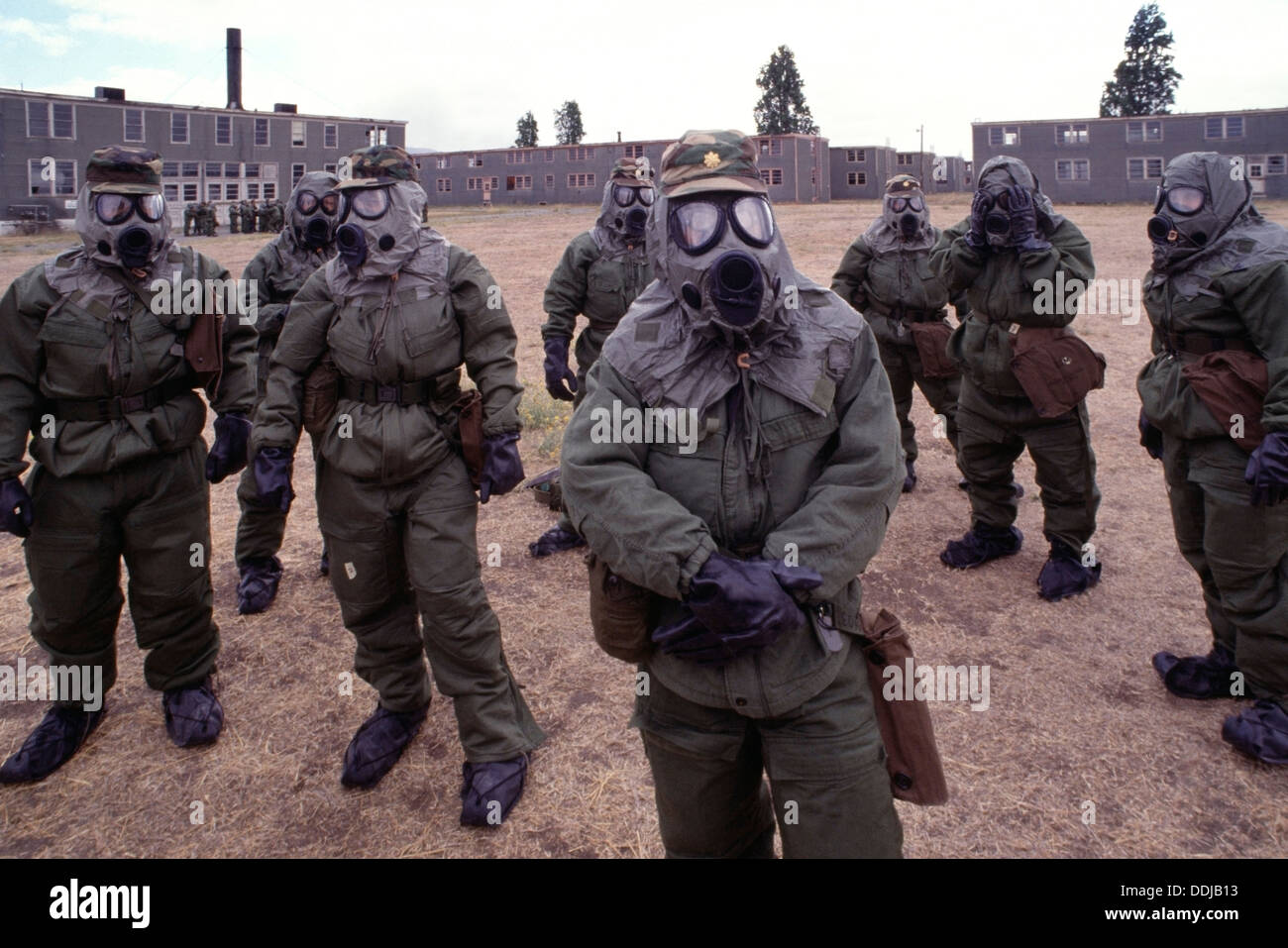 Doctors, 347th Army Medical Reserve unit wearing gas masks and protective clothing during chemical weapons training - Stock Image