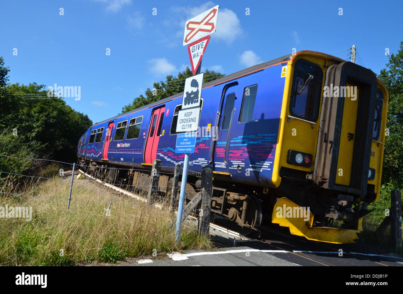 DMU passes Sandways Crossing heading for Gunnislake where this train will terminate. Pictured here on the 3rd September 2013. - Stock Image