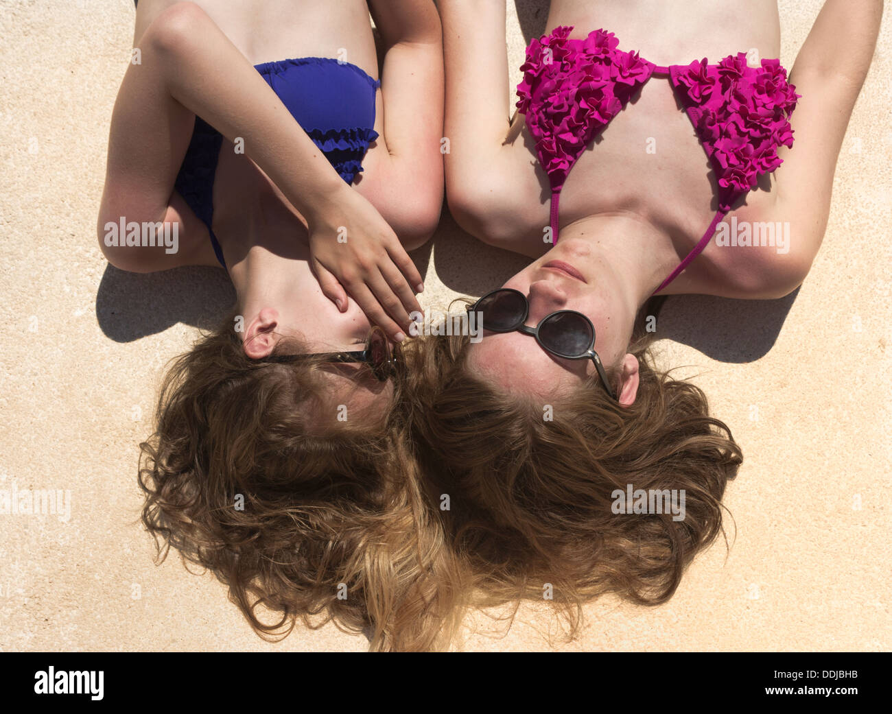 Two teenage girls whispering secrets. - Stock Image