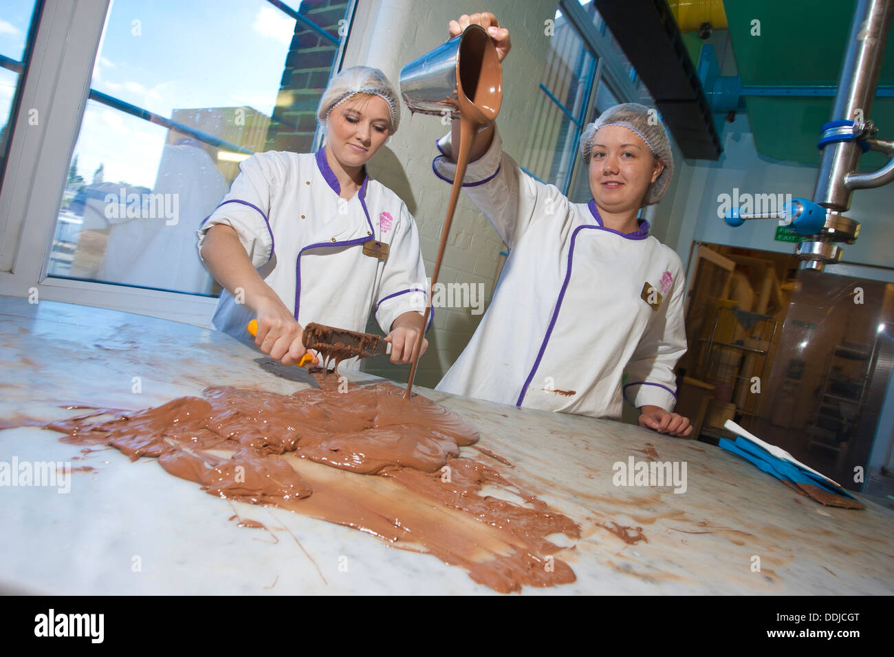 Workers At Cadbury World On The Site Of The Cadbury Chocolate Factory Founded By George Cadbury In 1879 England United Kingdom