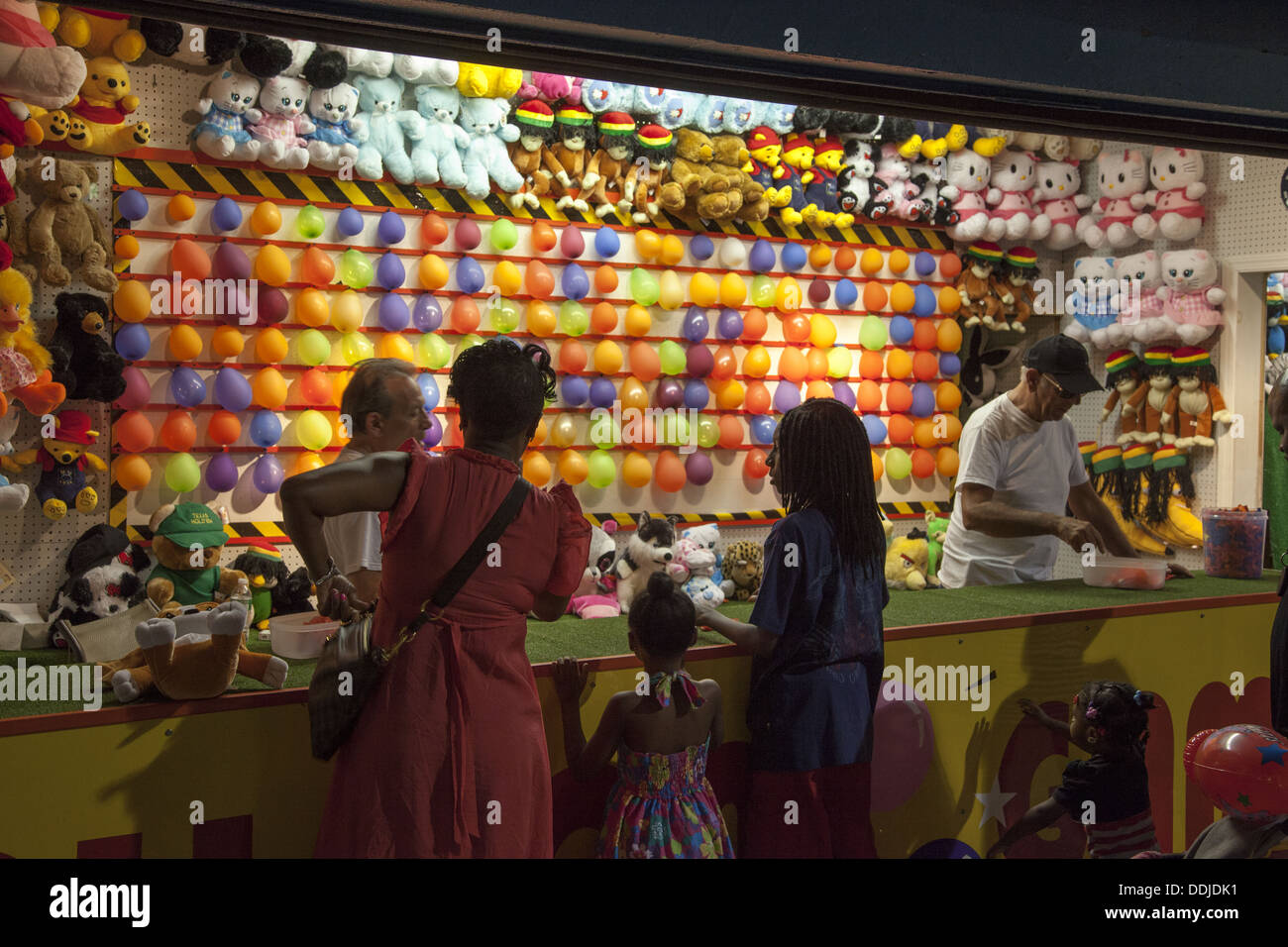 Pop a balloon and win a prize. Arcade, Coney Island, Brooklyn, NY. - Stock Image