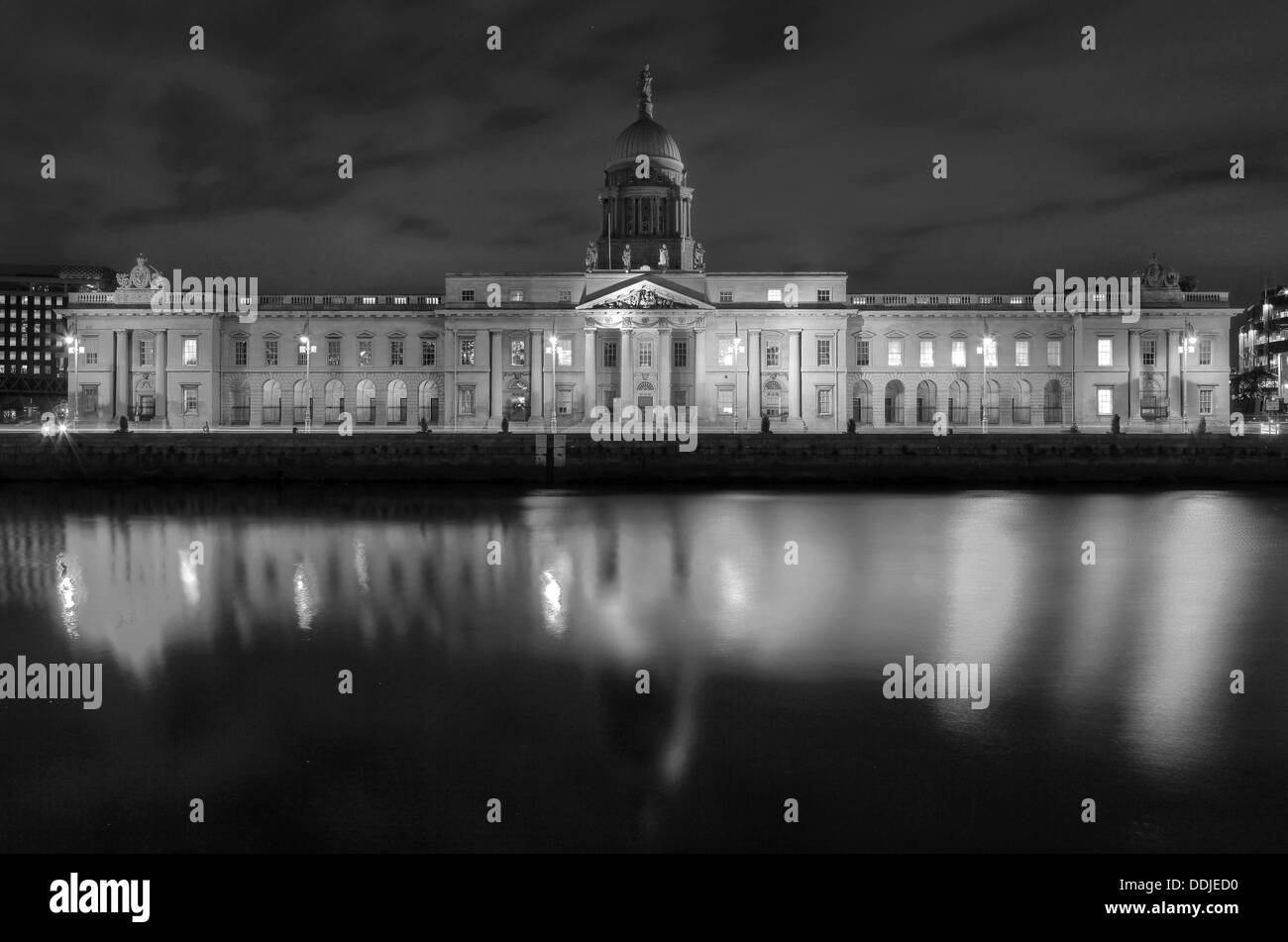 The Custom house reflected on the Liffey at night time in Black and white - Stock Image