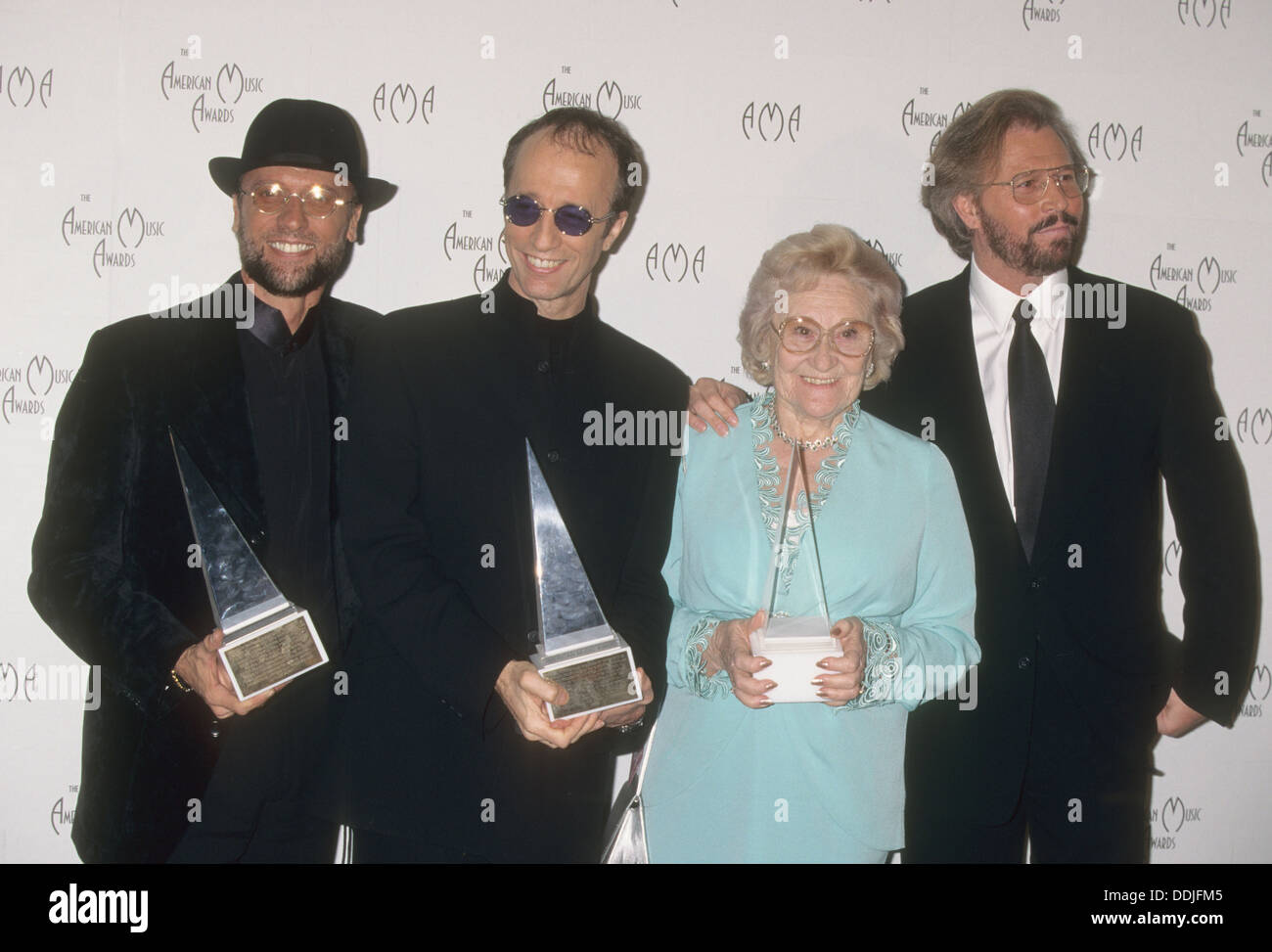 BEE GEES with their mother Barbara in January 1997. From l: Maurice, Robin and Barry. Photo Jeffrey Mayer - Stock Image