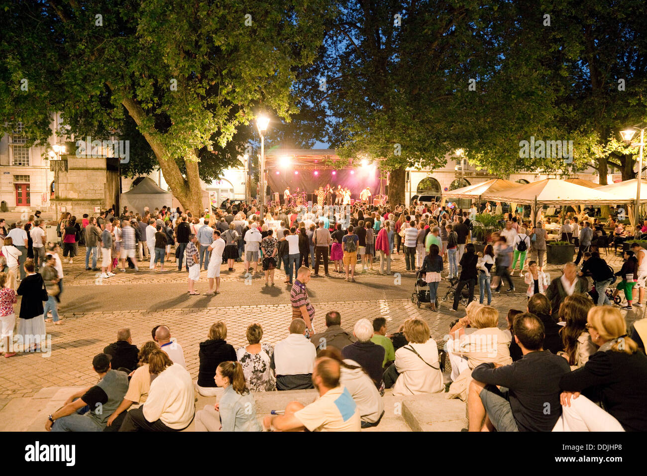 People listening to a concert in the town square at night, the town centre, Blois, Loir-et-Cher, Loire valley, France, Europe - Stock Image