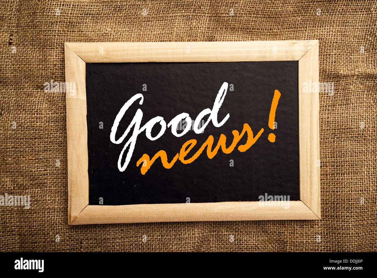 Good news message on black notice board - Stock Image