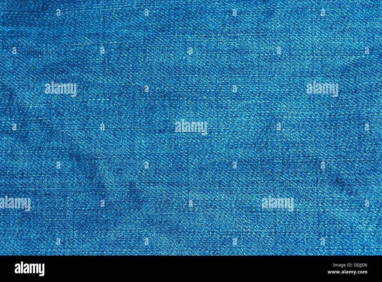 The texture of blue denim macro for the background and wallpaper. - Stock Image