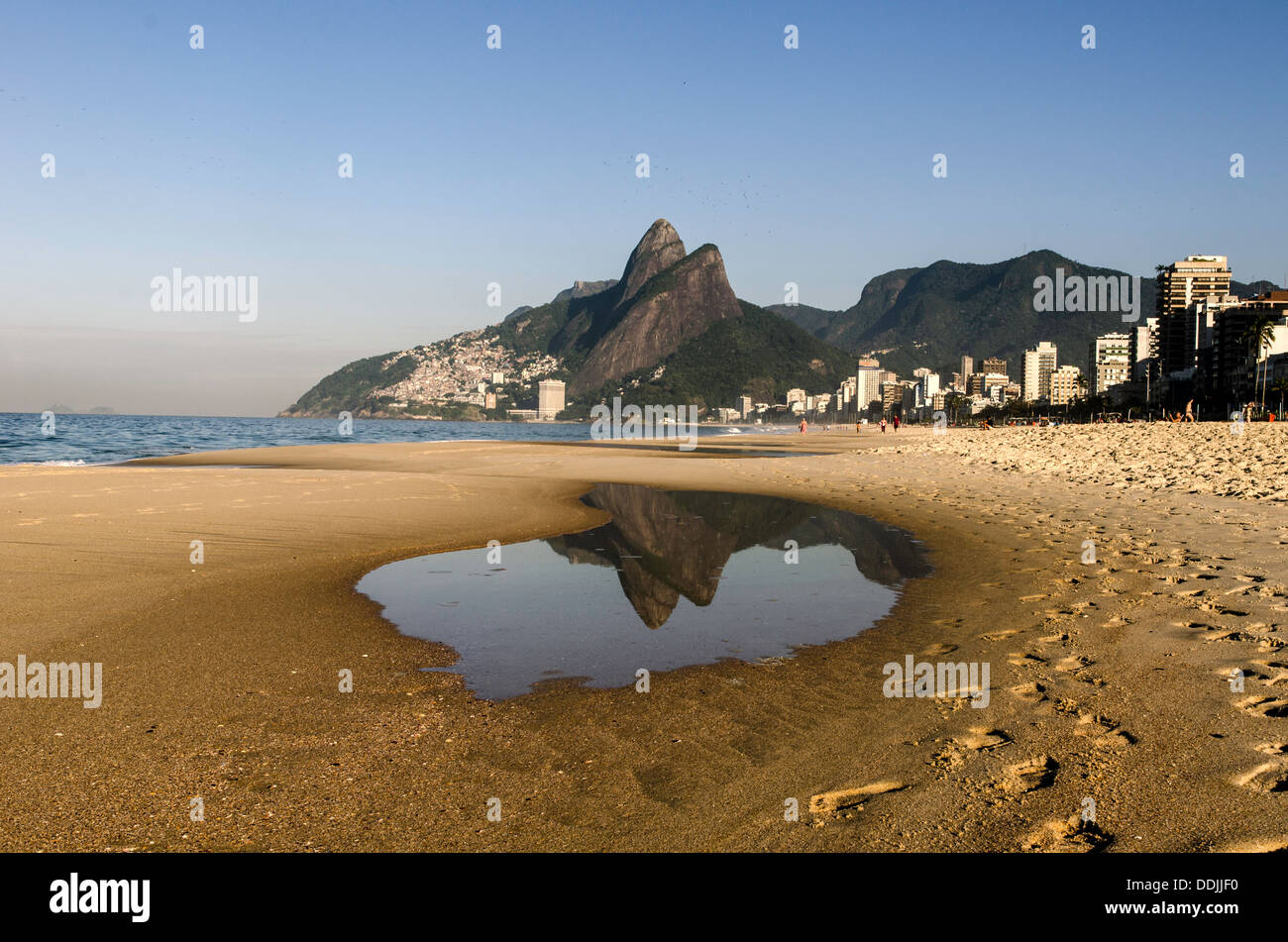 Ipanema beach with the Two Brothers rocks at sunrise Rio de Janeiro Brazil South America - Stock Image