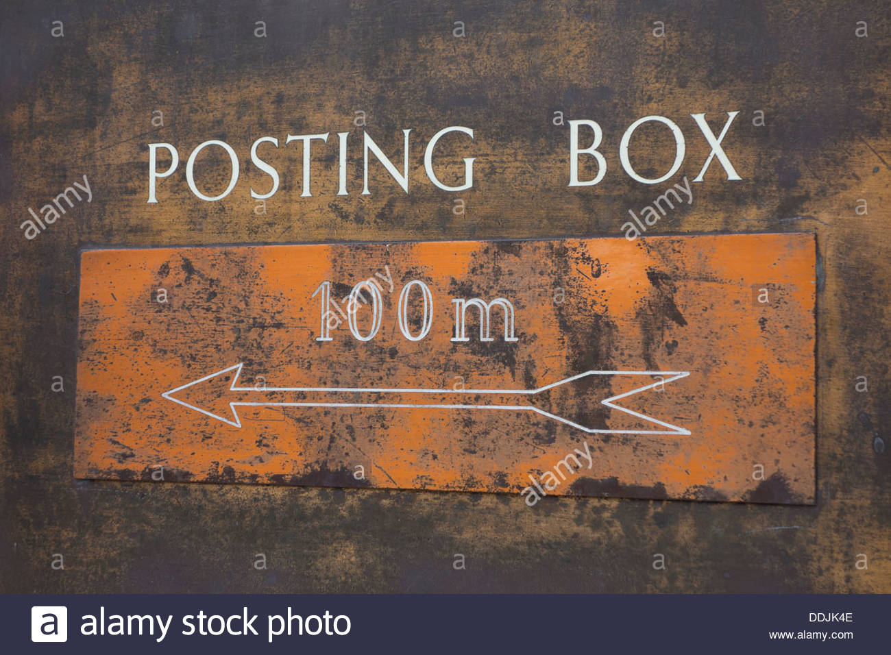Sign to posting box 100 metres. Stock Photo