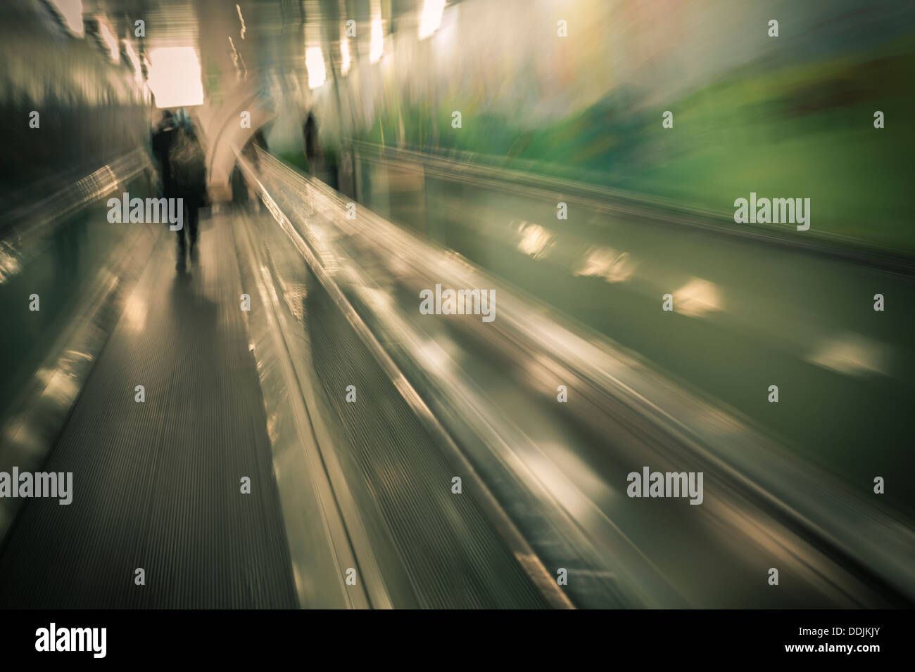 People on moving walkway to underground car park in Sydney, Australia. - Stock Image