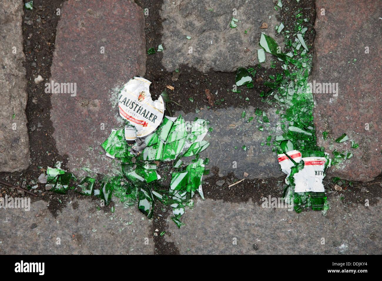 Broken beer bottle - many glass chips dangerous to people walking barefoot - Stock Image