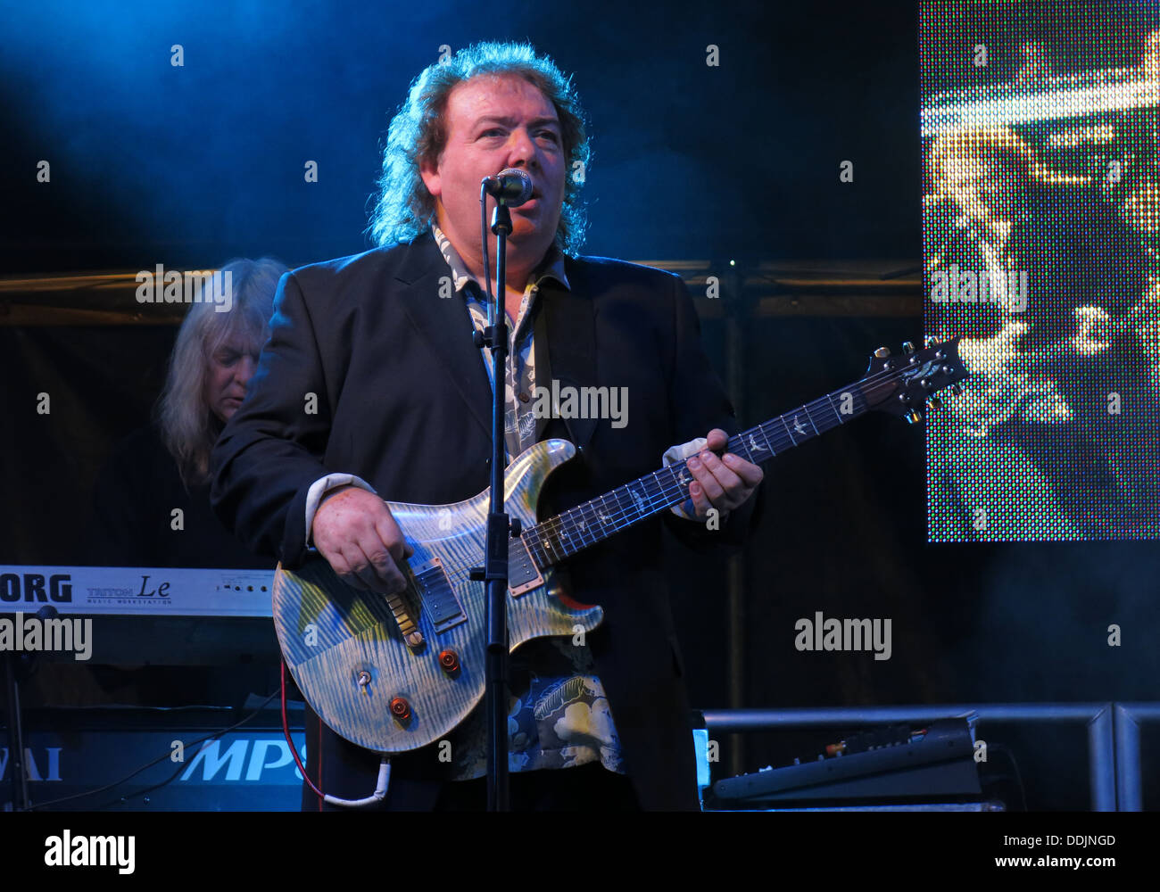 Bernie Marsden of Whitesnake at Silverstone 2013 British GP Grand Prix Woodlands stage with his guitar - Stock Image