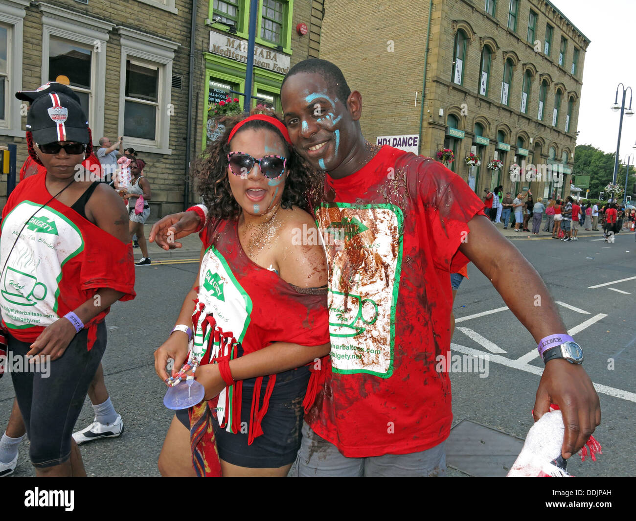 Costumed dancers from Huddersfield Carnival 2013 African Caribbean parade street party - Stock Image