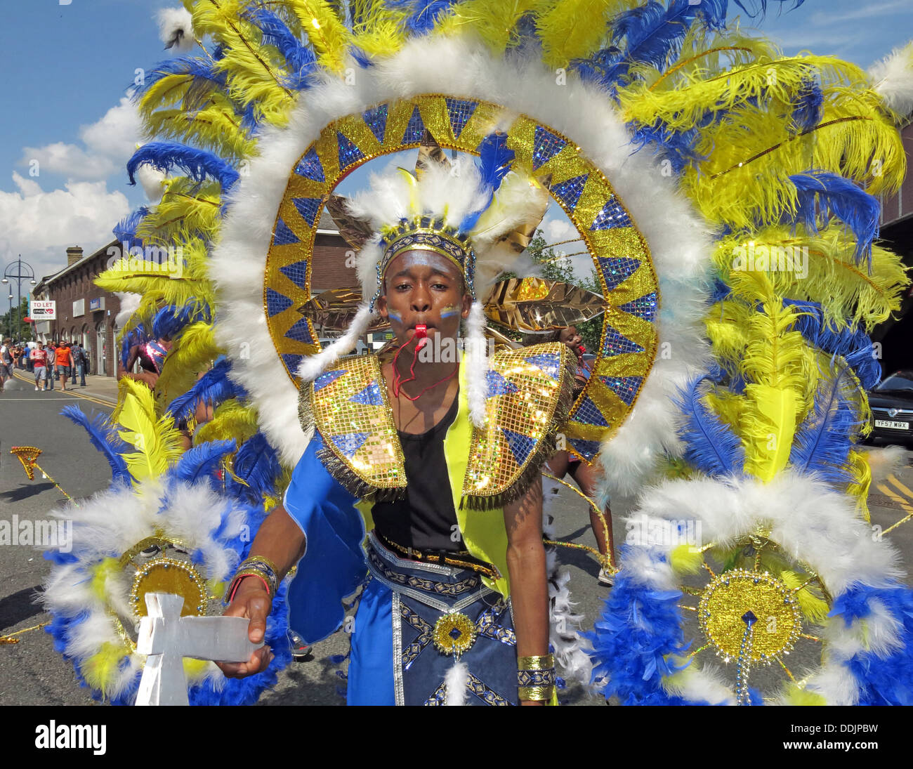 Costumed dancer in blue yellow from Huddersfield Carnival 2013 African Caribbean parade street party - Stock Image