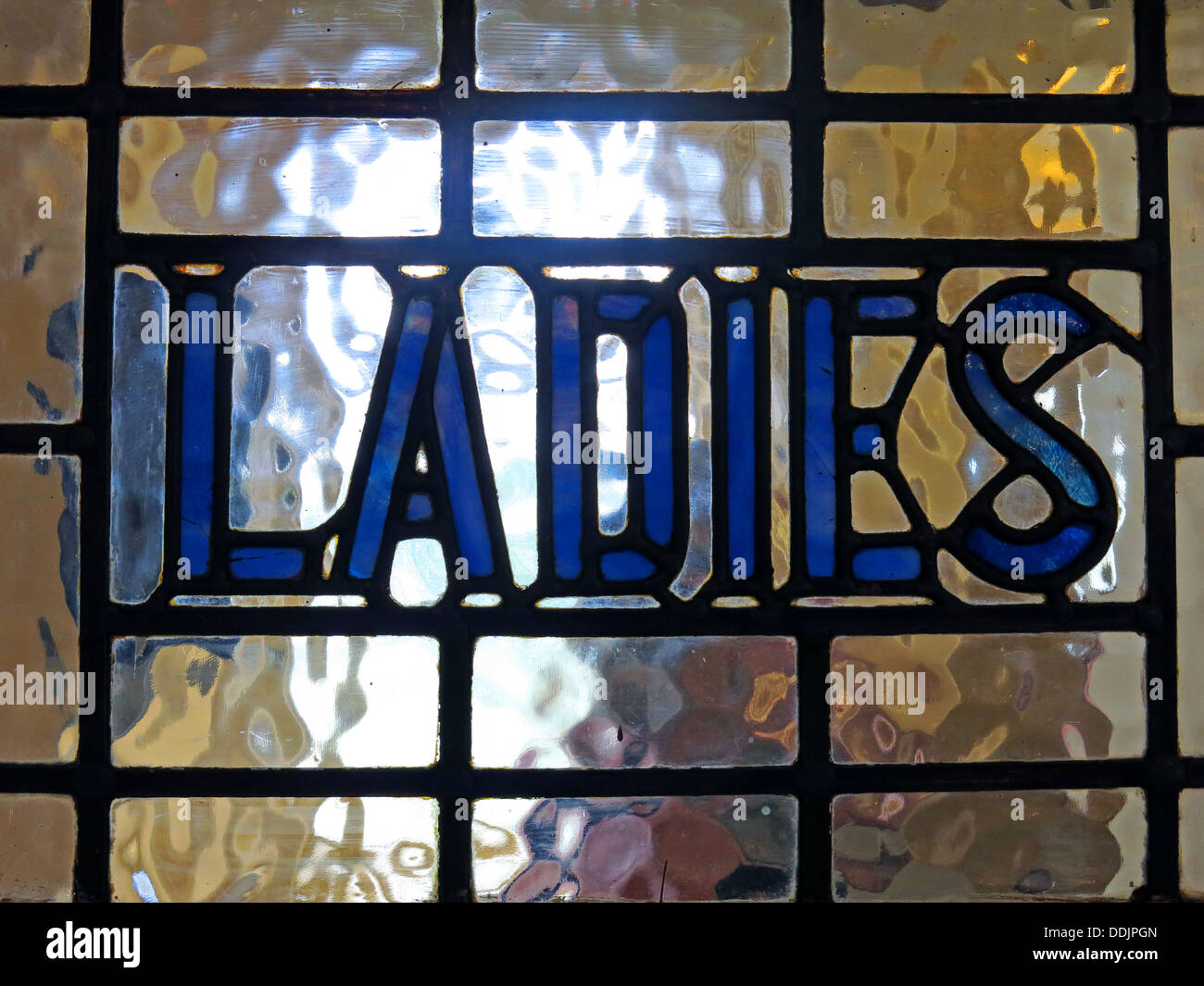 Ladies stained glass pub toilet door in blue , England , UK - Stock Image