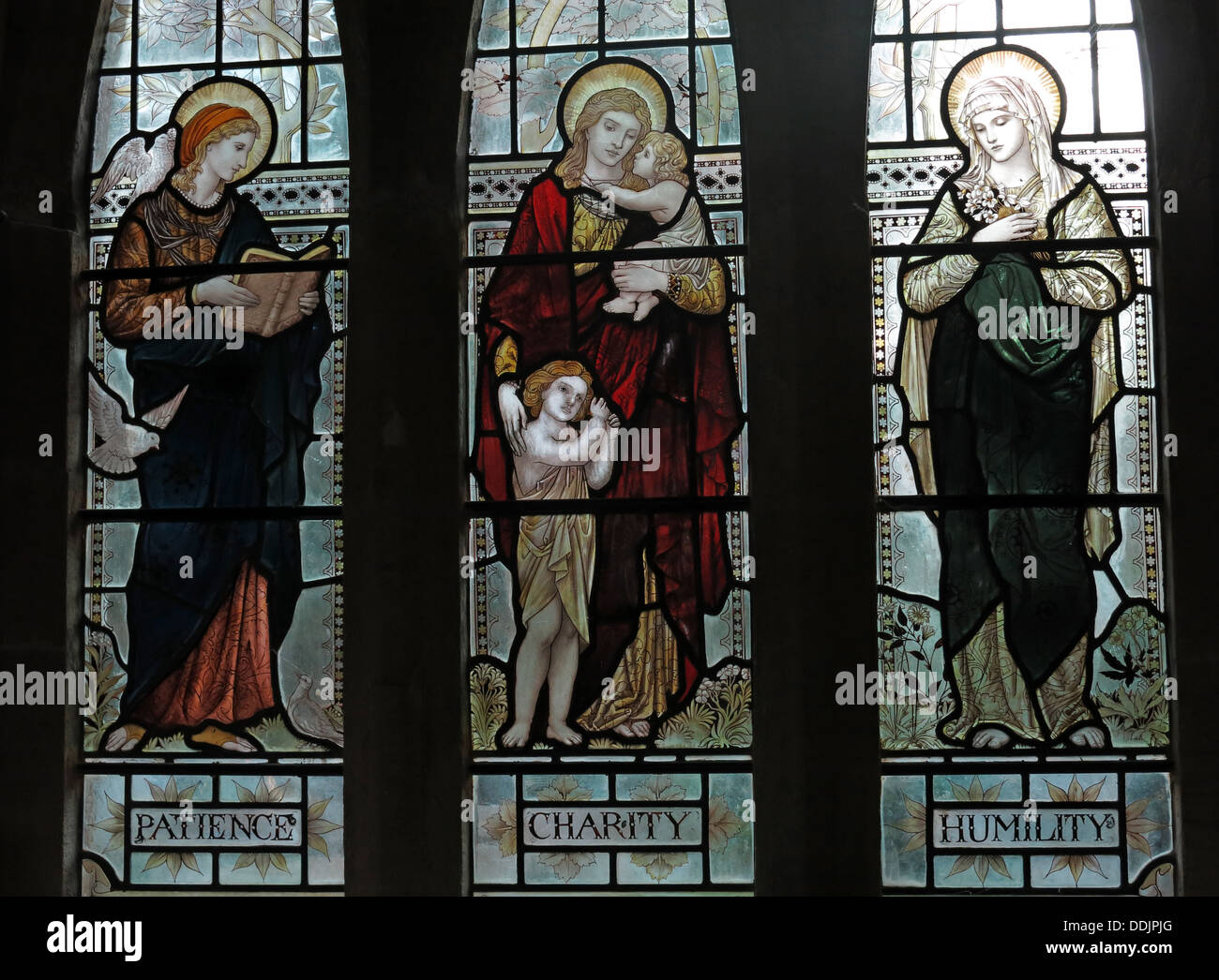 Patience Charity Humility Stained Glass in a church, South Window St Andrews Church Brympton D'Evercy Somerset England Stock Photo