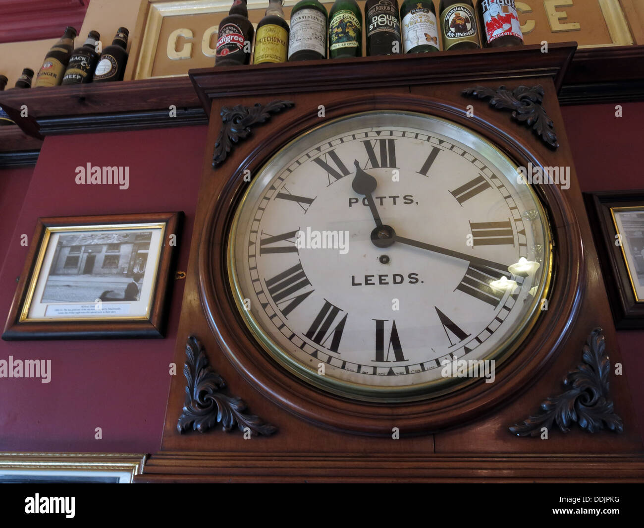 Potts Leeds clock at Dewsbury West Riding pub refreshment rooms, West Yorks, England, UK - Stock Image