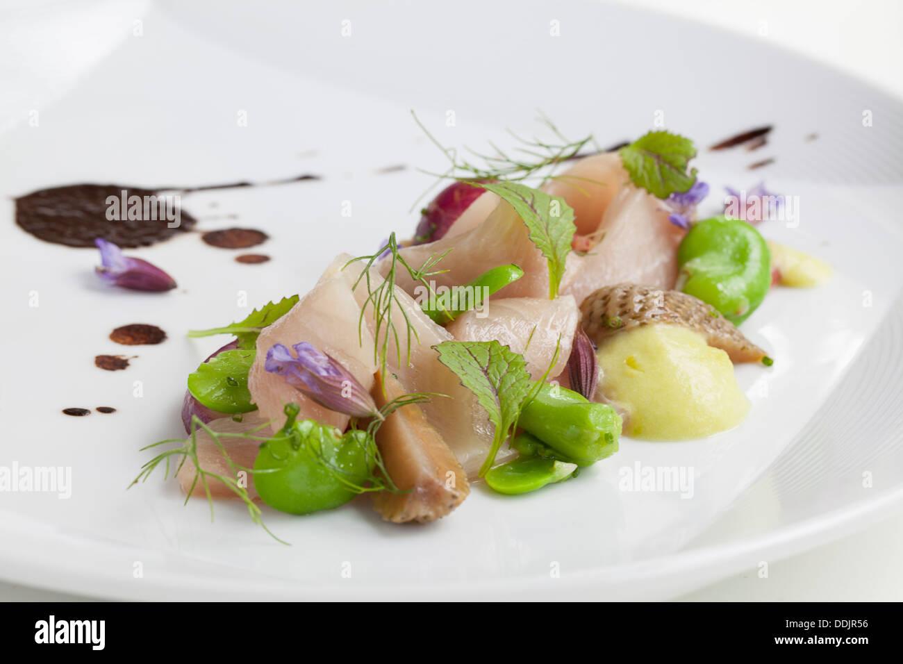 Hamachi Crudo Sushi With Pickles And Black Garlic Stock Photo
