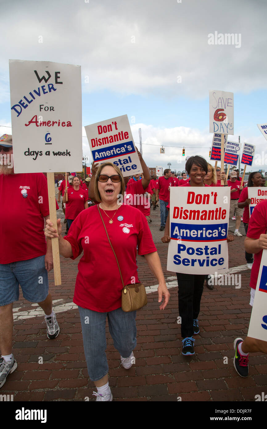 Letter carriers protest plans to cut mail delivery to five days a week. - Stock Image