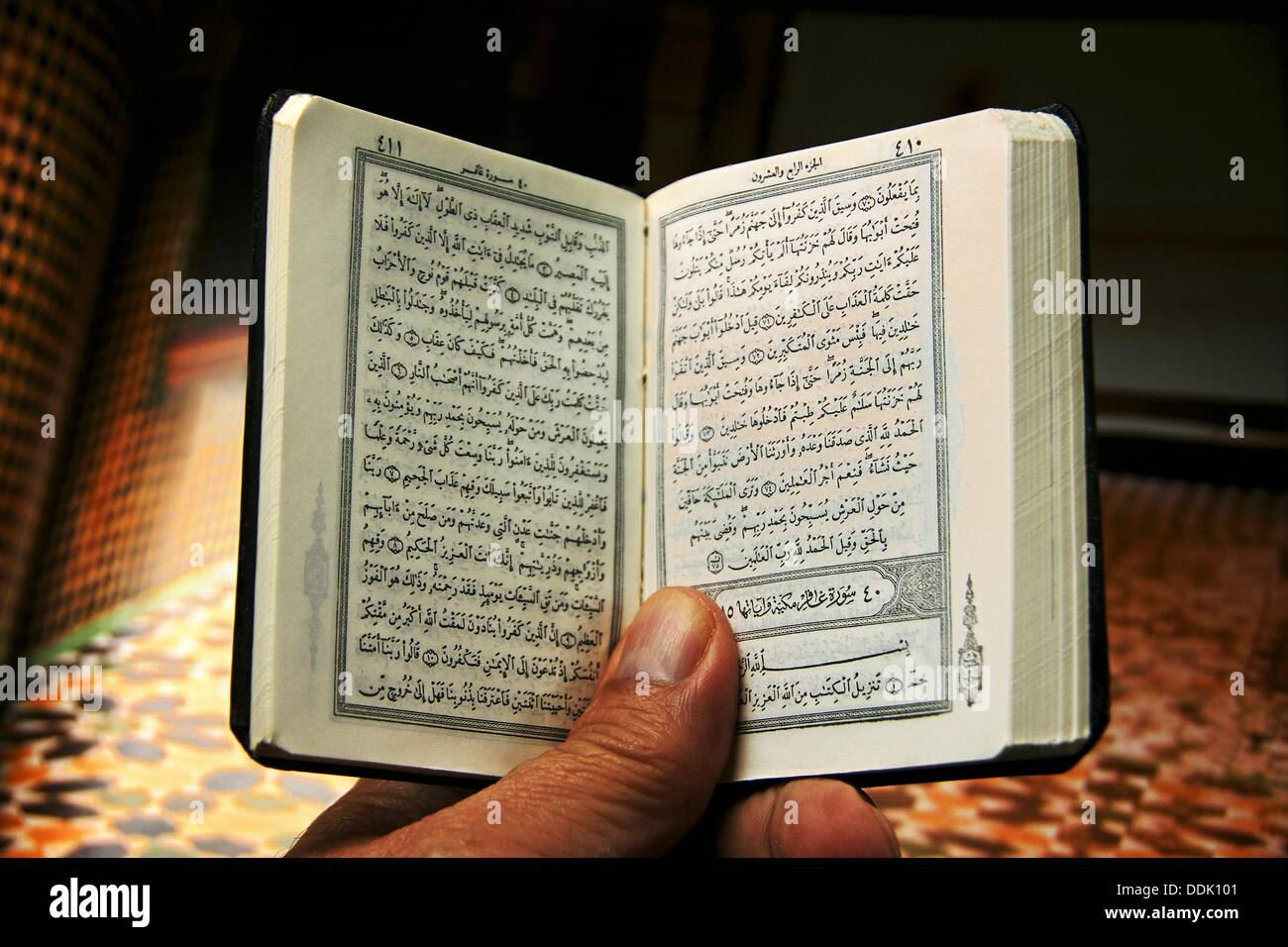 Reading the Quran - Stock Image