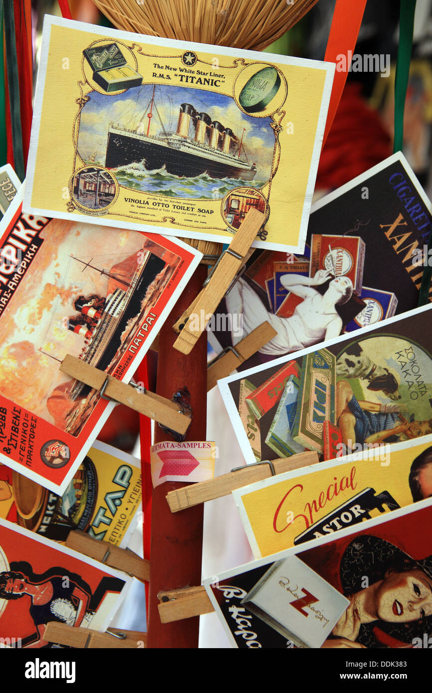 Postcards for sale clipped onto a display with clothes pegs - Stock Image