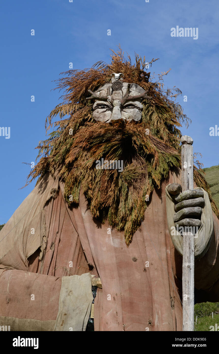 carved wooden statue of manannan on the isle of man - Stock Image