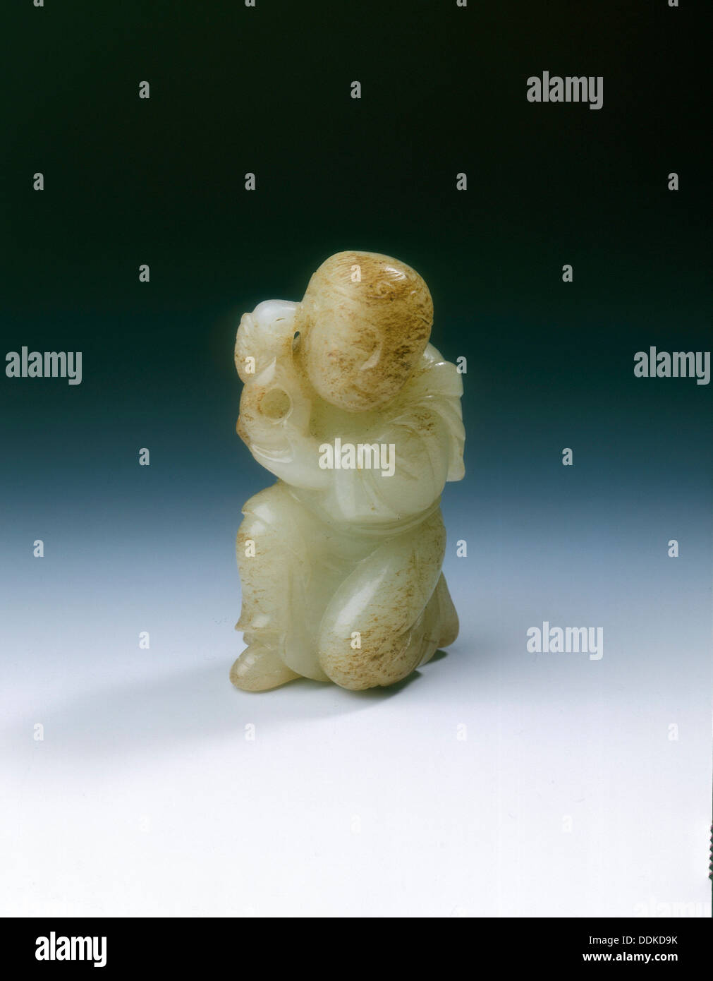 Yellowish jade kneeling tribute bearer, Tang or Liao dynasty, China, 8th-11th century. - Stock Image