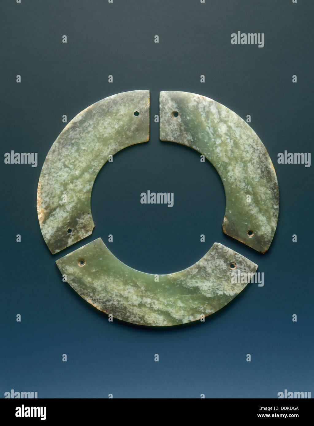 Jade bi-disc made up of three segments, Shang dynasty, Anyang phase, China, c12th-9th century BC. - Stock Image