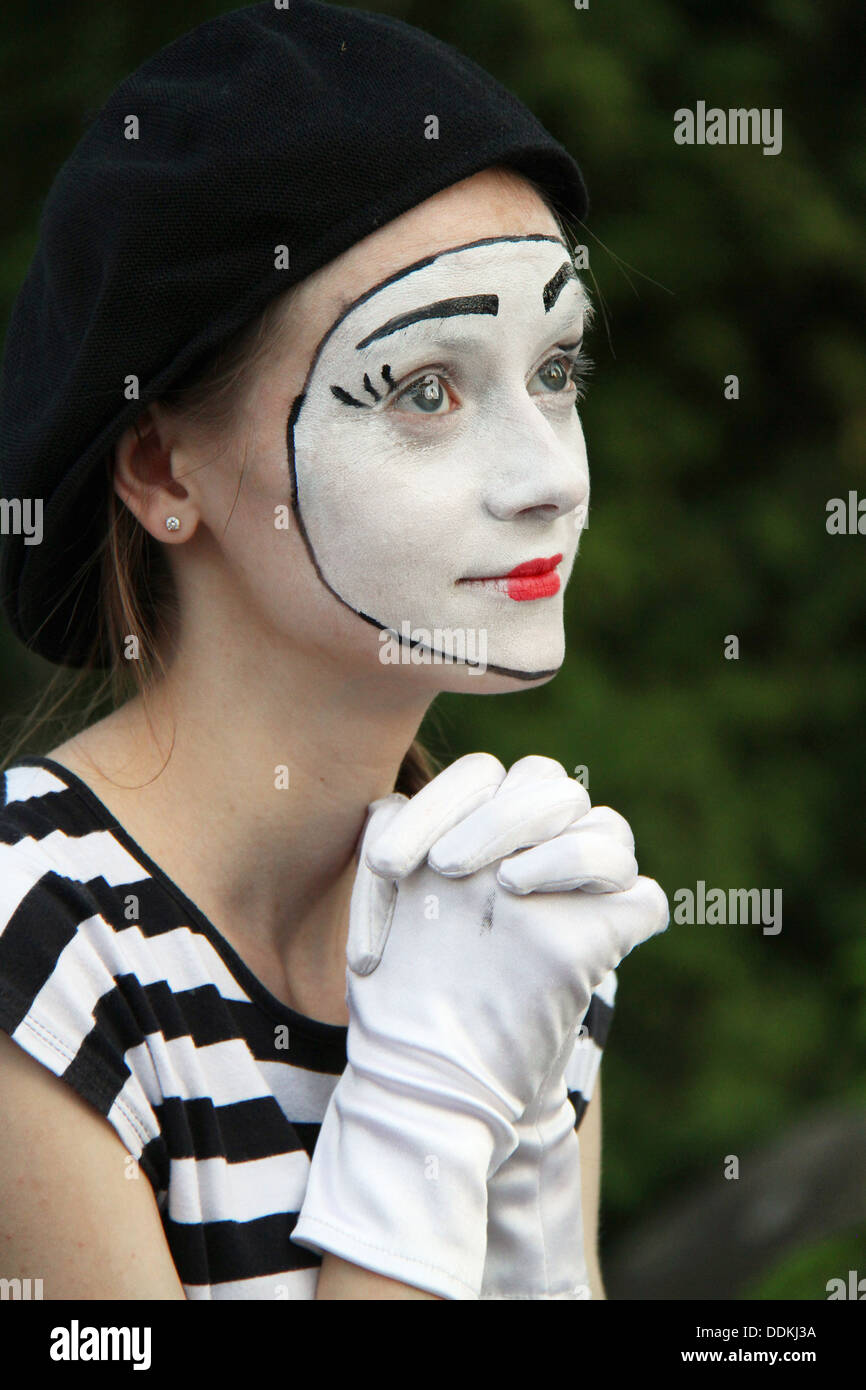 portrait of mim in white gloves on dark - Stock Image